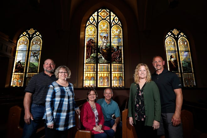 From left to right, couples Doug and Denise Klemp, Toni and Darrel Klemp and Shelly and Dave Klemp pose for a portrait Sunday, April 25, 2021, in Seymour, Wis. When Doug and Denise celebrated their 25th anniversary in March, it also marked a quarter of a century since they became the third Klemp-Schuelke married couple.