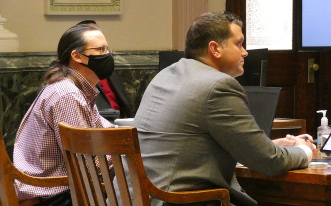 Josh Benedict, left, sits with defense attorney Adam Stone on Tuesday in Crawford County Common Pleas Court.