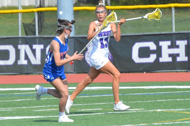 Cherry Hill West senior Jenna Casole looks for a teammate against Washington Township