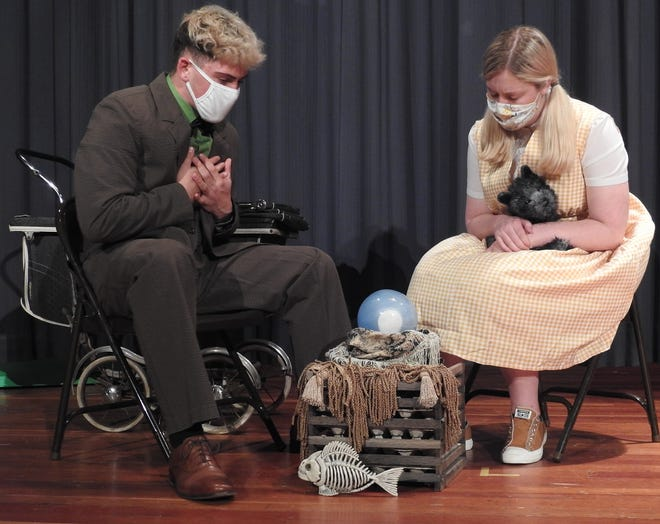 """Cole Tatro as Professor Marvelton and MaryAnn Lozowski as Dorothy rehearse a scene of """"The Wizard of Oz: Young Performers Edition"""" at River View High School. The show will have two live performances and be available for viewing online. Students will be wearing masks on stage and observing other precautions for the COVID-19 pandemic."""