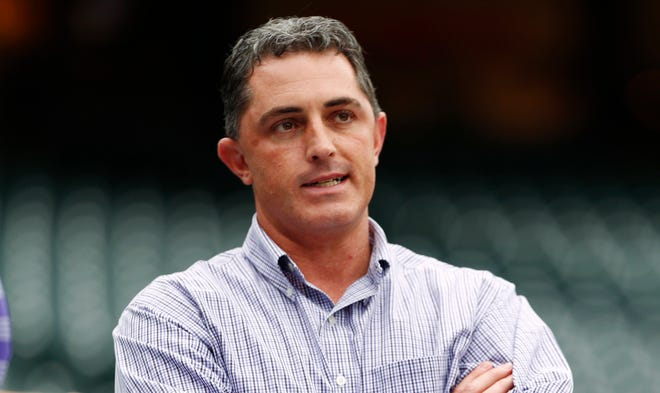 FILE - Colorado Rockies general manager Jeff Bridich looks on as the Rockies take batting practice before hosting the Washington Nationals in a baseball game in Denver.