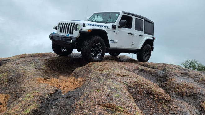 The 2022 Jeep Wrangler 4xe Rubicon adds the thrills of electrification - regen braking, quick acceleration - while not sacrificing its rugged off-road capabilities.