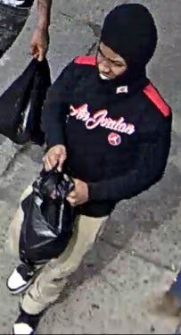 Surveillance image of the first suspect.