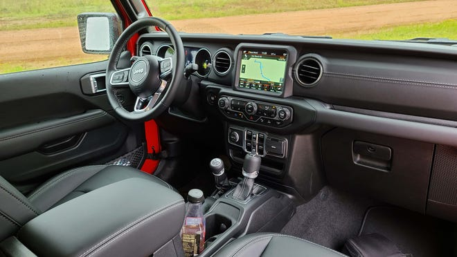 The interior of the 2022 Jeep Wrangler 4xe Sahara gets leather seats to go with rugged 4x4 transfer case.