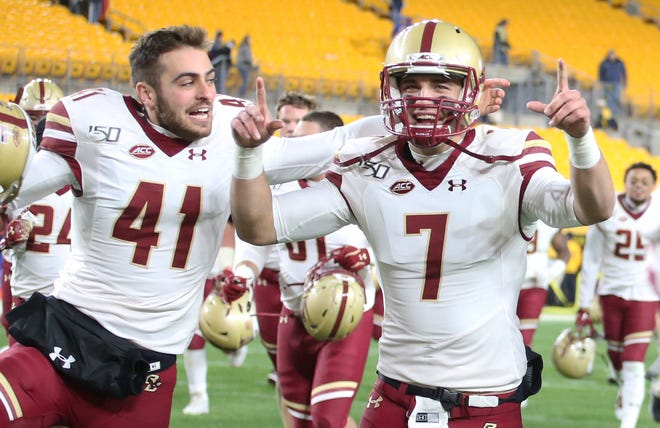 Quarterback Matt Valecce, right, celebrates with his Boston College teammates following a win at Pittsburgh on Nov. 30, 2019. Valecce said Monday on Twitter that he will transfer to Colorado State for his final two seasons of college football.