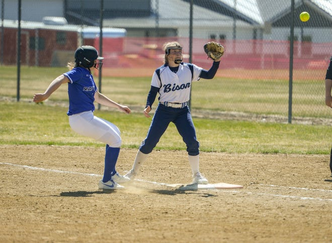 Great Falls High second baseman Ryen Palmer covers first base on a pickoff attempt from the catcher as Gallatin baserunner Makyah Albrecht attempts to get back to the base safely during a softball game at Multi Sports Complex last month.