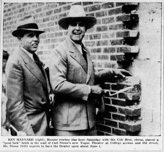 """Ken Maynard, """"Hoosier cowboy star"""" (right) placed a """"good luck"""" brick in the wall of the Vogue Theater, alongside Carl Niesse (left). May 10, 1938"""