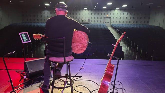 Country artist John Berry rehearses before his Valentine's Day at Williams Auditorium in Henderson in February.
