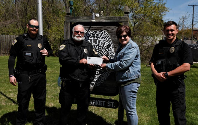 Baltimore Police Chief Mike Tussey, center left, presents a check to Susan Nixon-Stoughton Monday, April 26, with officers Jeff Lifer, far left, and Dylan Clark, far right. BPD raised $2,000 with the Beards for Bucks fundraiser for the benefit of the Lighthouse, a domestic violence shelter in Lancaster.
