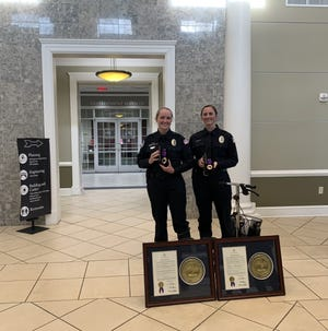 Officers Rachel Tigner (left) and Jacqueline Conlan received the Law Enforcement Purple Heart award Monday at the Collierville Board of Mayor and Aldermen meeting. The officers were injured while conducting a traffic stop in January.