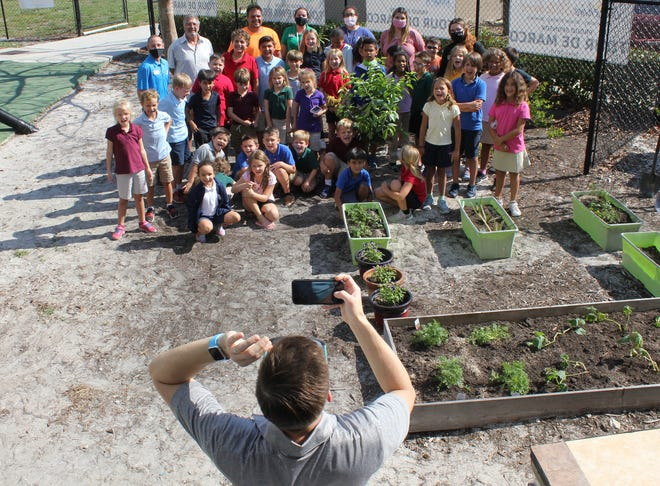 The group poses for a keepsake shot once the planting was completed.
