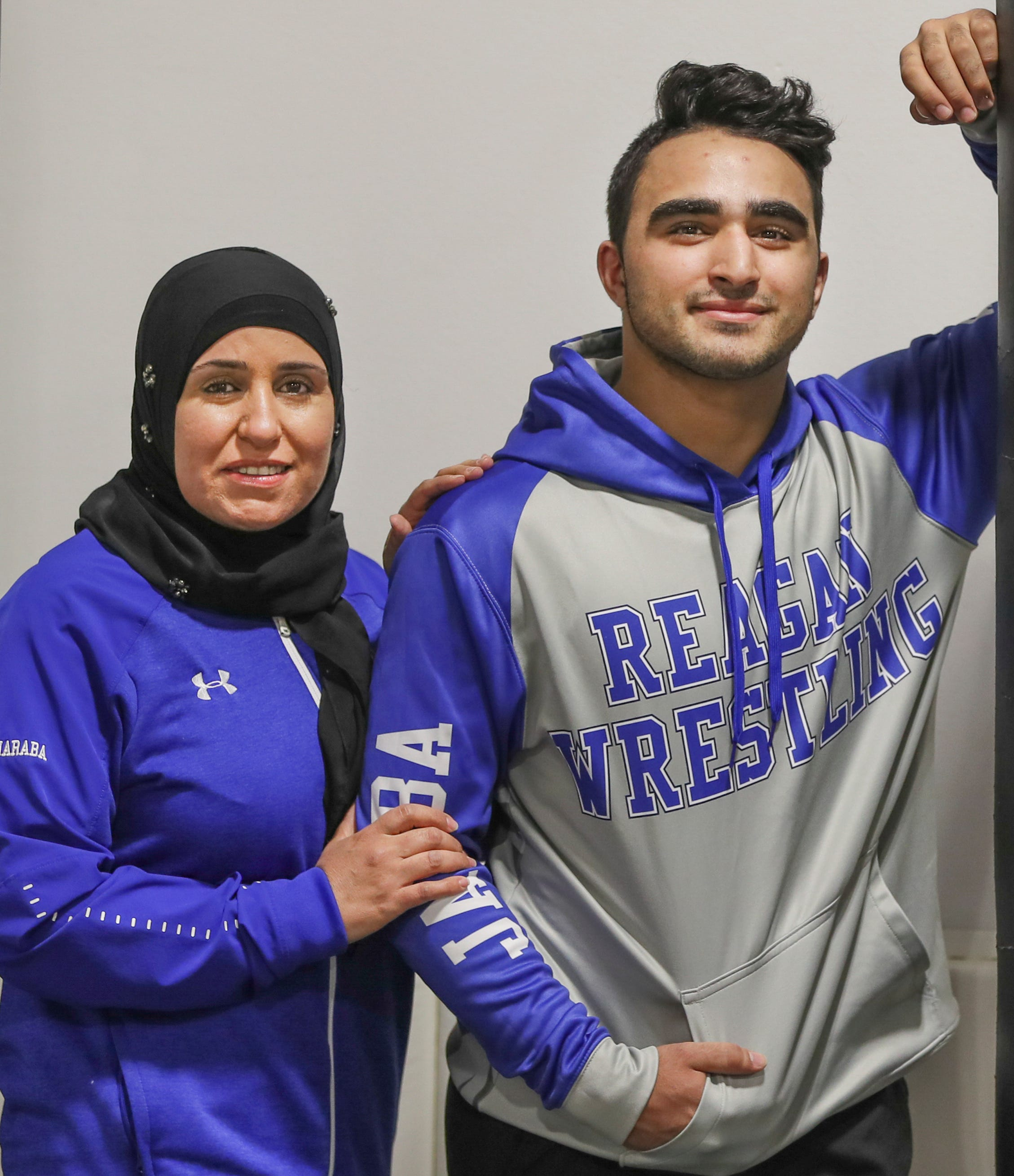 Renad Jaraba poses for a portrait with her 17-year-old son Layth April 13, 2021, at Pure Vida BBJ and MMA in Milwaukee.