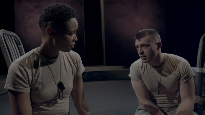 """An Army psychiatrist (Malkia Stampley, left) interviews a troubled soldier (Casey Hoekstra) in """"9 Circles,"""" performed by Next Act Theatre."""