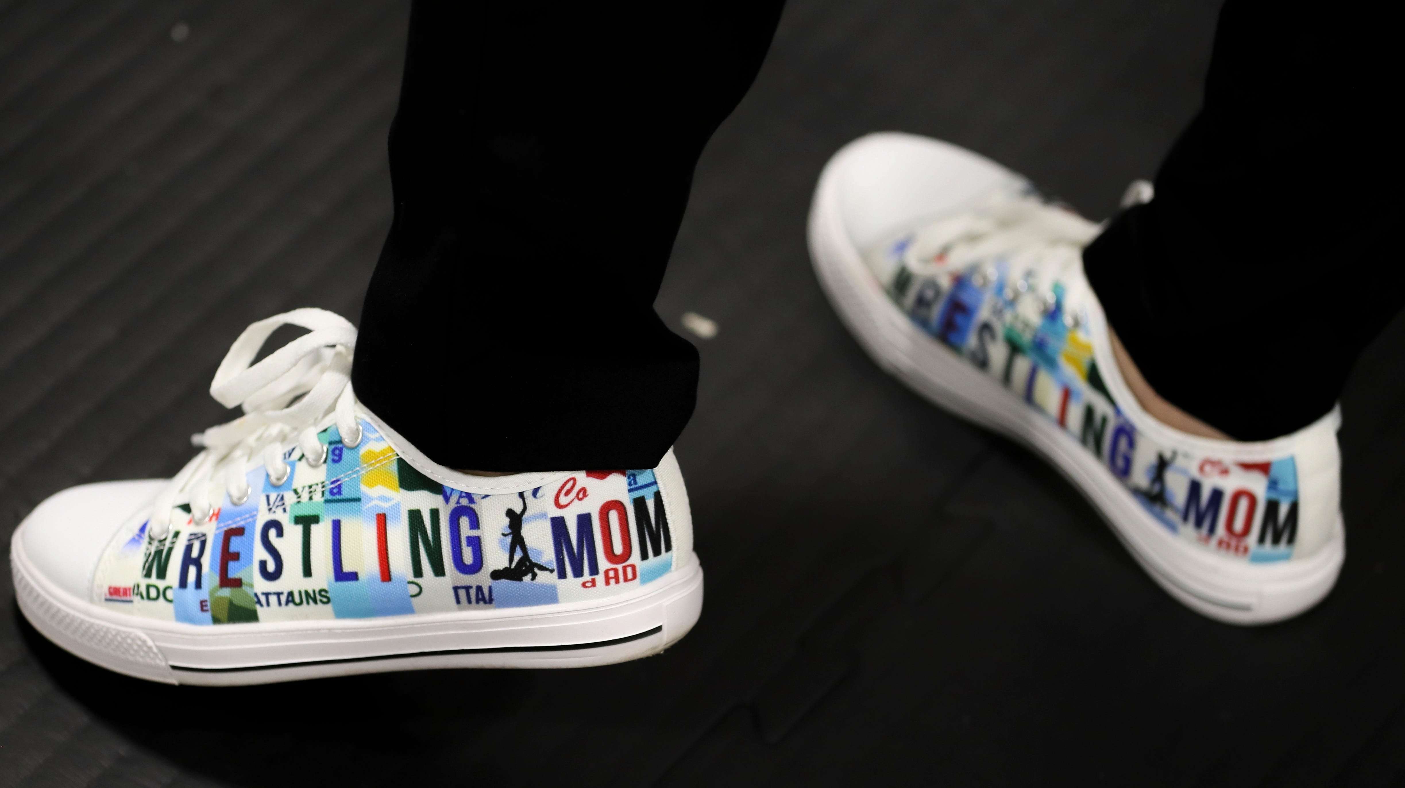 Renad Jaraba shows off her wrestling mom shoes April 13, 2021, at Pure Vida BBJ and MMA in Milwaukee.