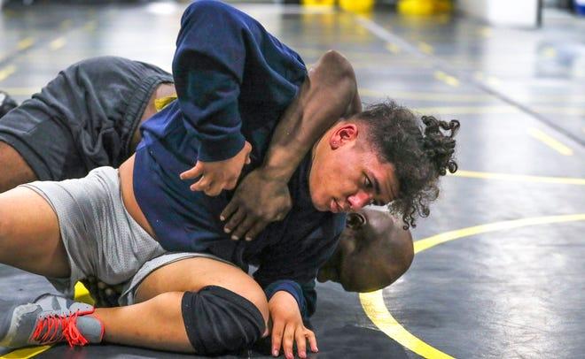 Jomar Matos, 15, wrestles his coach Malcolm Briggs April 15, 2021, at Pura Vida BBJ & MMA  in  Milwaukee.