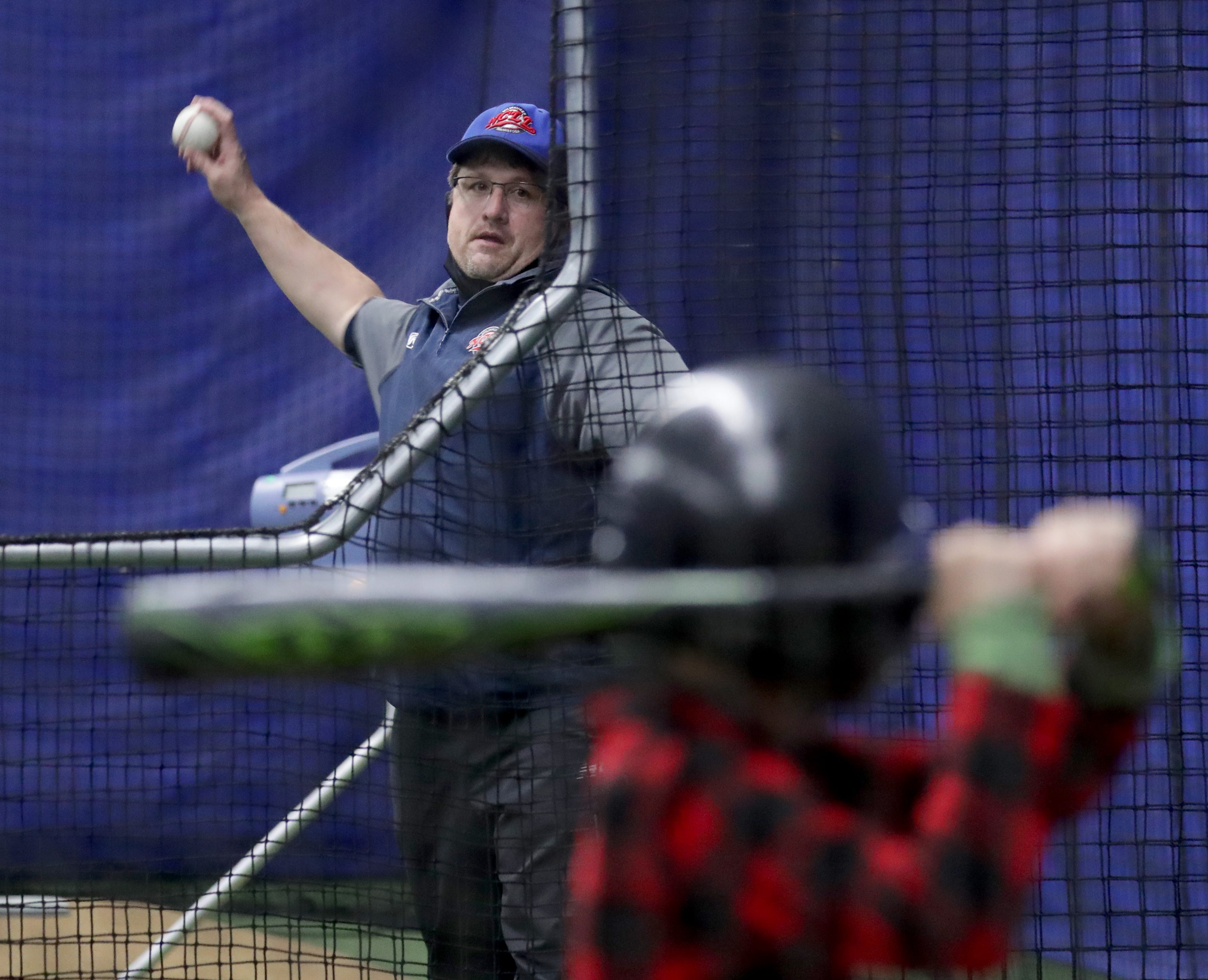 Tony Costa, president of North Central Little League, throws a pitch during player evaluations at the North Central Little League facility April 10, 2021.