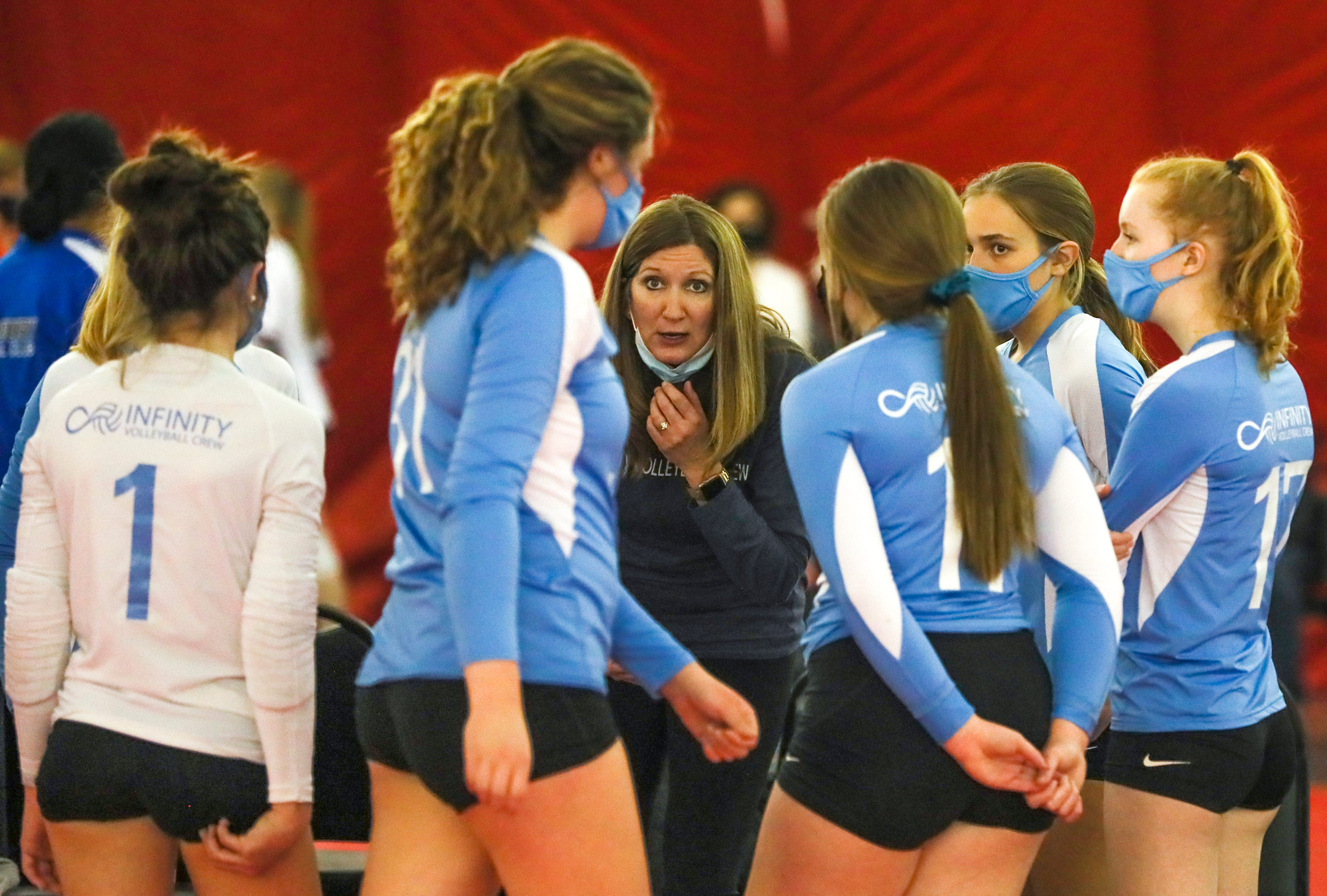 An Infinity Volleyball Crew coach speaks to her players during the Diggin' in the Dells volleyball tournament  April 17, 2021, at Woodside Sports Complex at Wisconsin Dells, Wis.