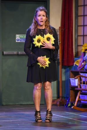 """Jackie Weiner, in the Naples Players' production of """"Calendar Girls,"""" contemplates, with trepidation, the possibilities for her photo session."""