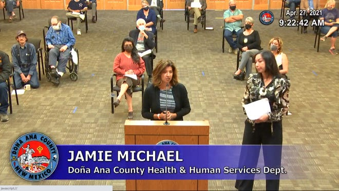 Speaking from a podium in front of the Doña Ana County Commission, County HHS Director Jamie Michael introduces Crisis Triage Center Site Director Karina Diaz at the commission meeting on April 27, 2021.