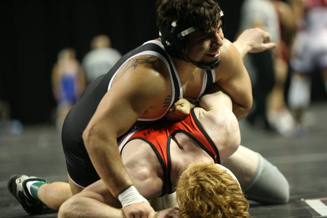 Iowa Western's Fabian Padilla, top, wrestles Western Wyoming's Collin Smith in fifth-place match of the 165-pound NJCAA Championships. Padilla won via decision, 4-1. With a Top-8 finish he earned All-American honors.