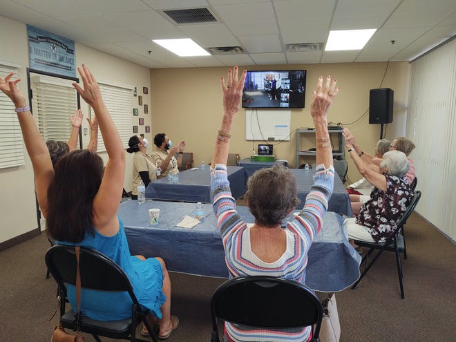 Club Journey participants learn stretching and breathing exercises from personal trainer Krissy-Lynn Lake via Zoom.