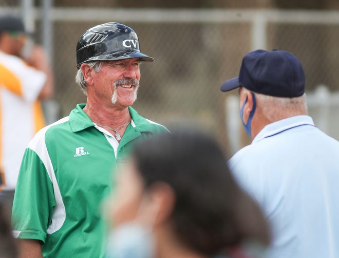Coachella Valley head coach Paul Salow talks with the umpire before their game against Cathedral City, April 26, 2021.  It was Salow's 400th win as head coach.