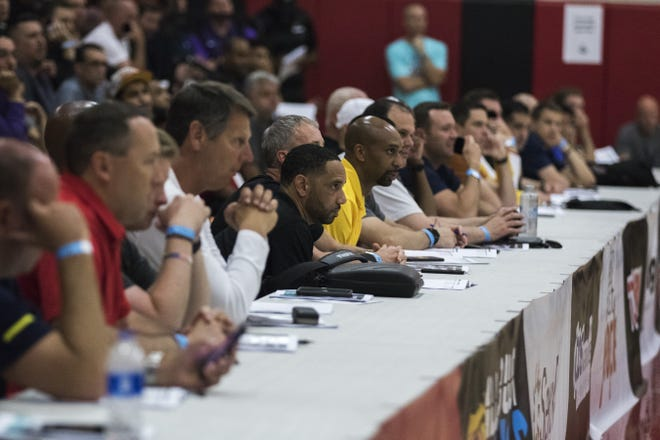College coaches from all over watch the Millennium-Mater Dei game during the Section 7 Basketball tournament at Brophy Prep High School in Phoenix, Friday, June 21, 2019.