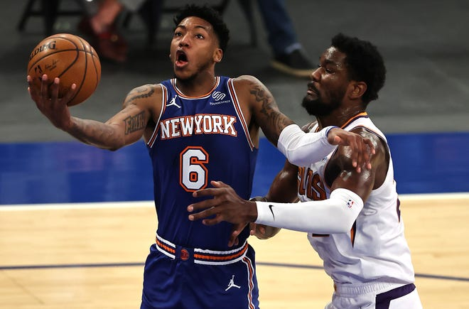 Apr 26, 2021; New York, New York, USA;  Elfrid Payton #6 of the New York Knicks heads for the net as Deandre Ayton #22 of the Phoenix Suns defends in the first half at Madison Square Garden. Mandatory Credit:  Elsa/POOL PHOTOS-USA TODAY Sports