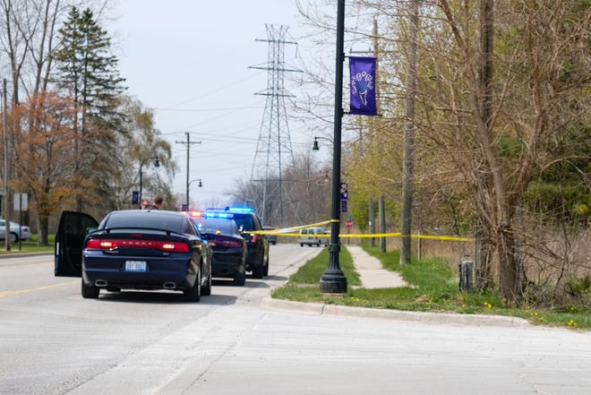 First responders investigate a body found along Howard Street Tuesday, April 27, 2021, in Port Huron Township. The man has been identified as Samuel Ian Pearson.