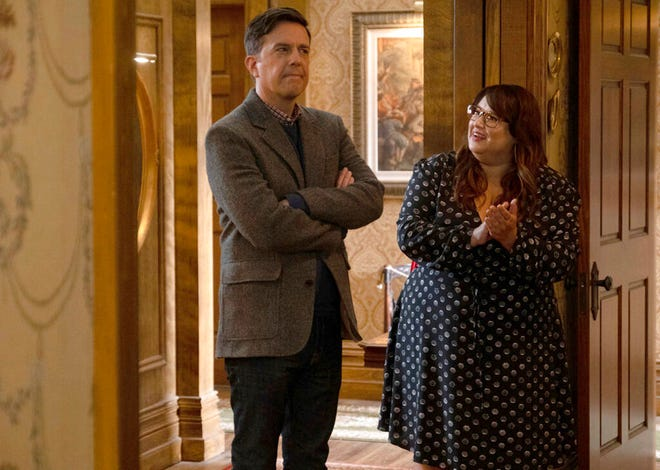 """This image released by Peacock shows Ed Helms as Nathan Rutherford, left, and Jana Schmieding as Reagan Wells in a scene from the comedy series """"Rutherford Falls."""" (Colleen Hayes/Peacock via AP)"""