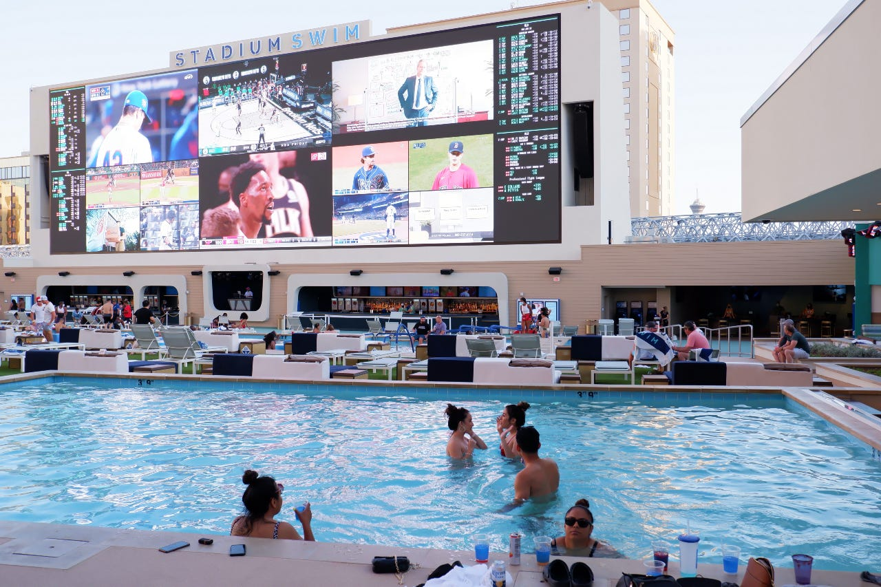 Shots in arms, money in pockets: What a Friday night at the hottest pool in Las Vegas is like