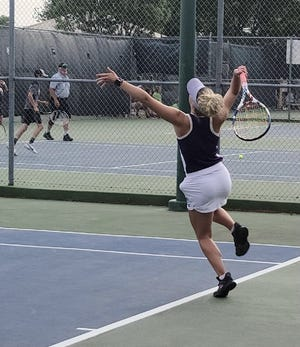 Irion County High School's Melanie Rainey serves the ball during the championship match in the girls singles division at the Region II-1A Tennis Championships Tuesday, April 27, 2021, at Bentwood Country Club.