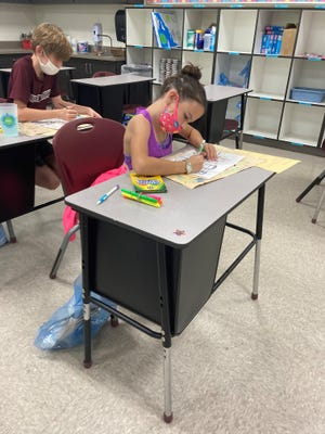 DeSoto Trail fifth grader Victoria Whitney uses supplies from her art bag.