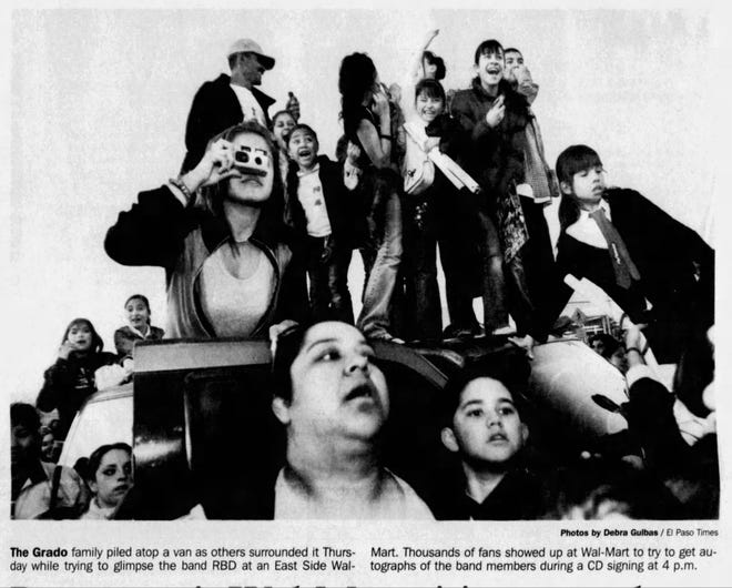 Jan. 13, 2006 The Grado family piled atop a van as others surrounded it Thursday while trying to glimpse the band RBD at an East Side Wal-Mart to try to get autographs of the band members during a CD signing at 4 p.m.