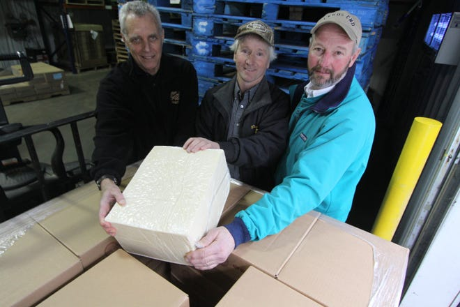 Ten years ago the Dairy Pricing Association made its first purchase of finished dairy product at Meister Cheese in Muscoda. Pictured are, from left, Tom Scheuerman, Food Resource Manager for Second Harvest Food Bank in Madison, and dairy farmers Tom Olson and Robin Berg. Scheuerman has since retired and Berg has switched from dairy to beef production; Olson is still dairy farming and is now president of the DPA.