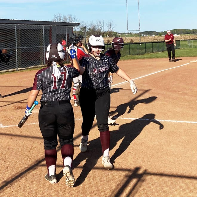 John Glenn's Bella Birkhimer, left, congratulates Sydney Marshall after scoring a run in the fifth inning against Sheridan on April 26 in Thornville. John Glenn won 9-0 to improve to 22-0 and stay atop the Muskingum Valley League's Big School Division.