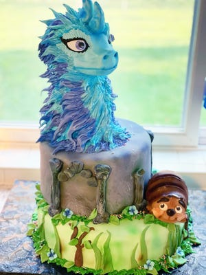 The Times Recorder's Raya and the Last Dragon cake by Shala Aitken will be up for bids at 5:45 p.m. Wednesday.