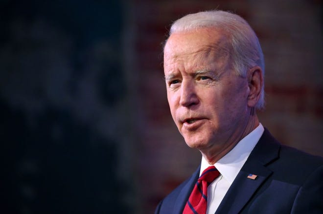 US President-elect Joe Biden delivers remarks on his plan to administer COVID-19 vaccines on January 15, 2021, at The Queen Theater in Wilmington, Delaware.