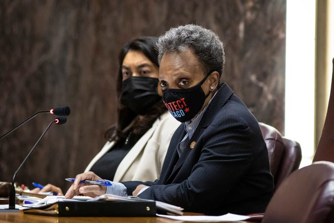 Chicago Mayor Lori Lightfoot presides over the Chicago City Council meeting at City Hall, Wednesday morning, April 21, 2021. Wednesday marked the first in-person council meeting since the start of the coronavirus pandemic more than a year ago.