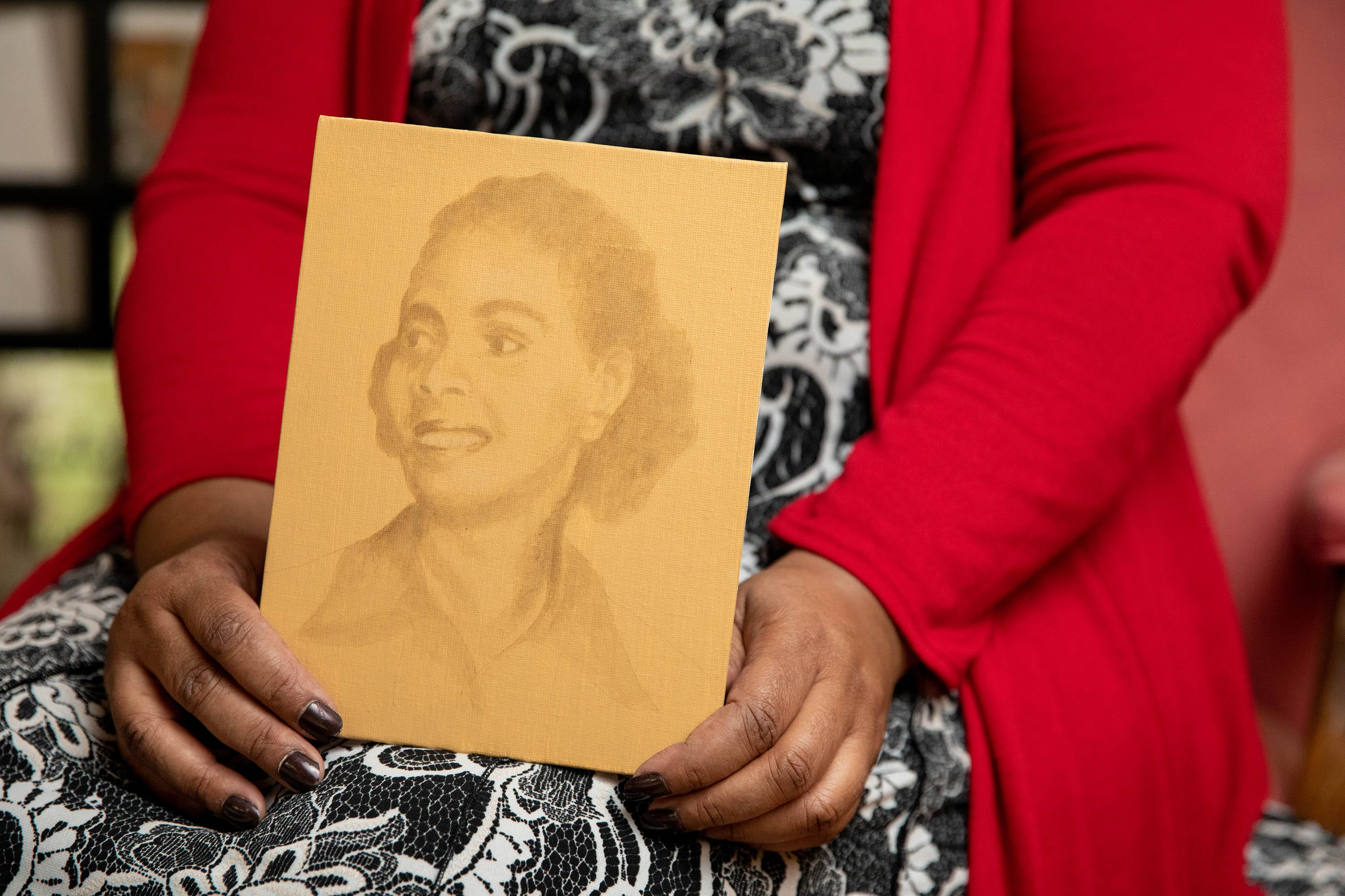 Janine Bacquie, of Rockville, Md., holds a sketch of her grandmother Irene Morgan, the plaintiff in the landmark Supreme Court case Morgan vs. Virginia.