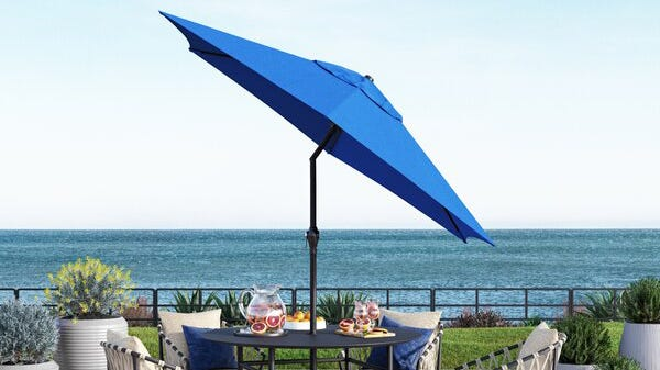 Beachcrest Home's 9-foot patio umbrella is both spacious and adjustable thanks to its tilted design.