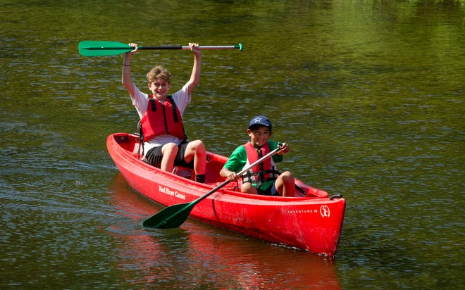 Jaden Phillips, 13, left, and Jaden Hernandez, 8,  canoe at the YMCA's Camp Moody in Buda in 2018. The camp is open for summer this year.