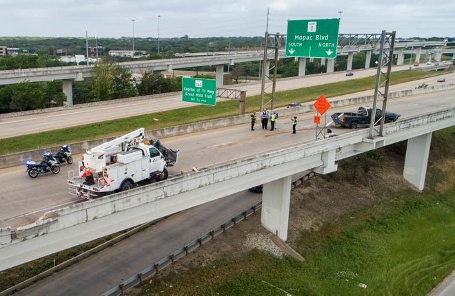 First responders work at the scene of a fatal accident on the north  U.S. 183 flyover to south MoPac Boulevard on Wednesday April 28, 2021.