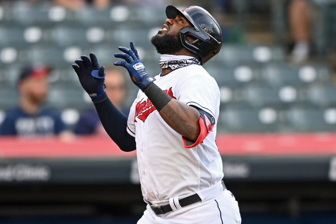 Designated hitter Franmil Reyes (32) celebrates after hitting a solo home run in the second inning of Cleveland's 7-4 win over the Minnesota Twins on Tuesday night at Progressive Field. (AP Photo/David Dermer)