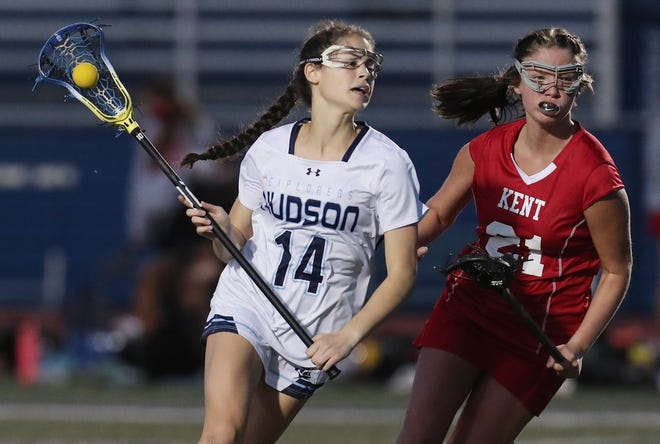 In this file photo, Hudson's Peyton Farley moves with the ball in the second half of a lacrosse match against Kent Roosevelt at Hudson High School on Tuesday April 27, 2021. The Explorers fell to Upper Arlington on Saturday May 5, 2021, in a measuring-stick game as far as the postseason goes, 17-9. [Mike Cardew/Akron Beacon Journal]