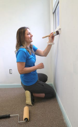 Stow Senior Center Recreation Supervisor Kathy Lewis paints the center's office area on April 28. The senior center has been closed throughout the pandemic, and there is no reopening date yet.