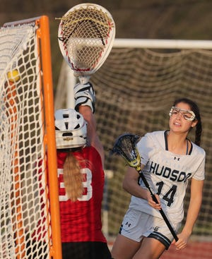 Hudson's Peyton Farley scores against Kent Roosevelt in the first half of their lacrosse match at Hudson High School on Tuesday April 27, 2021. Hudson defeated Kent Roosevelt 18 to 0. [Mike Cardew/Akron Beacon Journal]