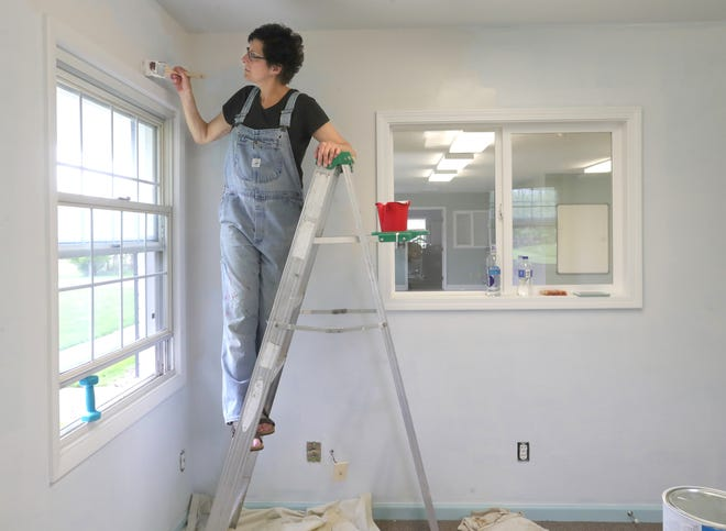 Stow Senior Center Program Assistant Cindy Cloud paints the office area of the converted home on April 28. The city's parks and recreation department is using the pandemic-related closure to make minor repairs to the senior center.