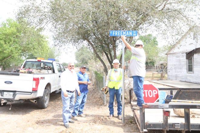 County Commissioner Wicho Gonzalez, Foreman David Ruiz, Ernesto Morales and Jacob Salinas installing 70 new street signs in Ben Bolt, Texas.