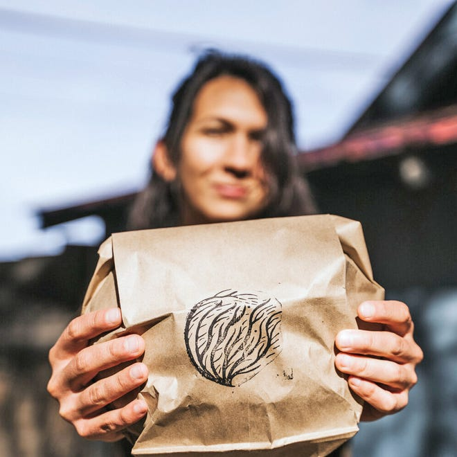 Jessica Larriva, owner of Tumbleweed Bread, shows off the packaging she uses for her naturally leavened and fermented sourdough loaves and pastries. The bread is sold through a subscription service and will also be available for sale at farmers markets in Alamosa and Monte Vista this summer. [Tumbleweed Bread photo]
